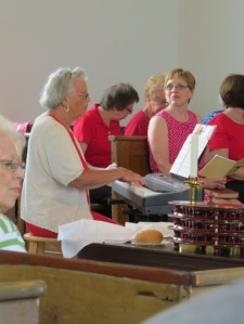Song leader, Ann Makin, plays the keyboard while the congregation belts out in song, like the Welsh people they are.